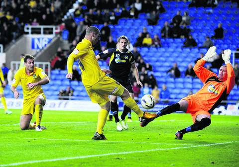 Torquay goalkeeper Martin Rice does enough to stop Oxford striker James Constable finding the net in the 0-0 draw at the Kassa