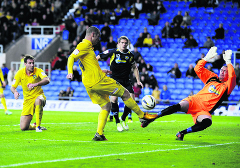Torquay goalkeeper Martin Rice does enough to stop Oxford striker James Constable finding the net in the 0-0 draw at the Kassam Stadium on Saturday