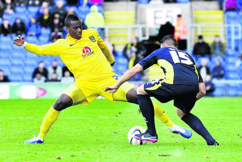 Liam Davis and Torquay's Billy Bodin battle it out on Saturday