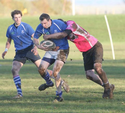 Littlemore's Jonny Williams attacks against Faringdon