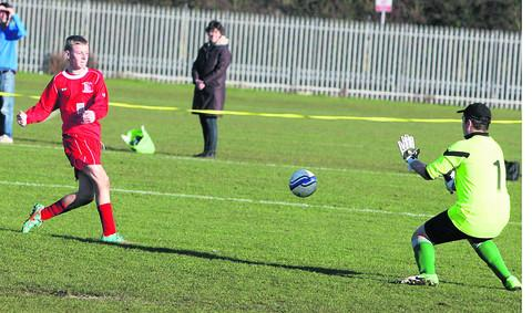 Headington's Liam Costar fires in a shot during the Under 13 D League clash, but Kidlington goalkeeper James Lendhart saves well. Costar scored twice as his side won 4-2