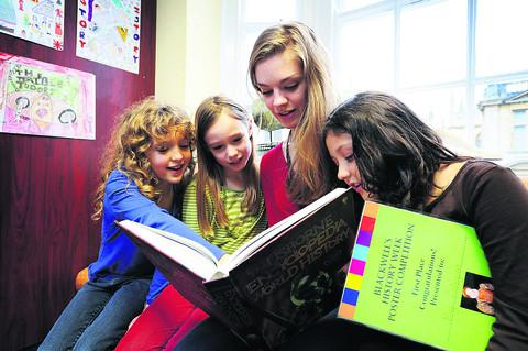 Eight-year-olds Hannah Perry, Laura Wilkinson and Maya Finlayson, of St Ebbe's School with competition organiser Emily Sergeant. Picture: OX55440 Jon Lewis