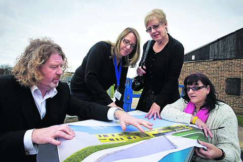 Architect Simon Kneafsey shows residents, from left, Julia Woodley, Sheila Cudlip and Sharon Bates how the community centre could look