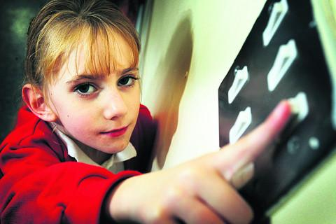 Oxford Mail: Seven-year-old pupil Olivia Page at Rose Hill Primary School