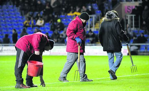 Oxford Mail: Groundsmen make running repairs at half time in a U's game