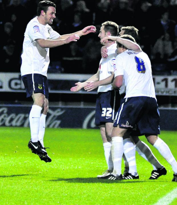 Tom Craddock (left) celebrates scoring at Chesterfield two seasons ago