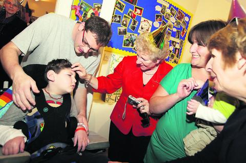Oxford Mail: Judith Price, centre, whose daughter Melissa was Helen House's first guest returned for its 30th anniversary where she met Jack Smith, eight, left, and his mum, Jane, right, and care team member, Andrew Jackson