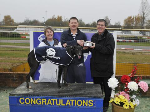 Absinthe with owner Jonathon Miles, seen receiving his trophy from BAGS chairman Tom Kelly (right) with trainer Angie Kibble