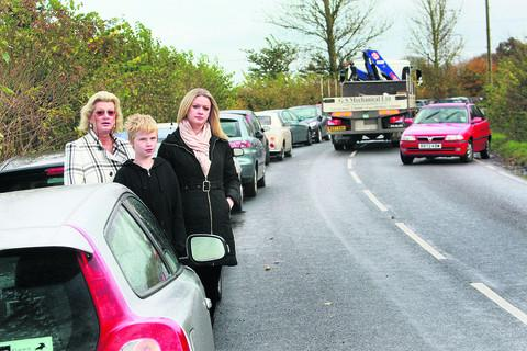 Judy Harding-Saunders with Harry Driscoll and Victoria Harding-Saunders at Holton Mill, Waterperry Road, where the number of students' cars parked is making driving hazardous. Picture: OX55332 Antony Moore