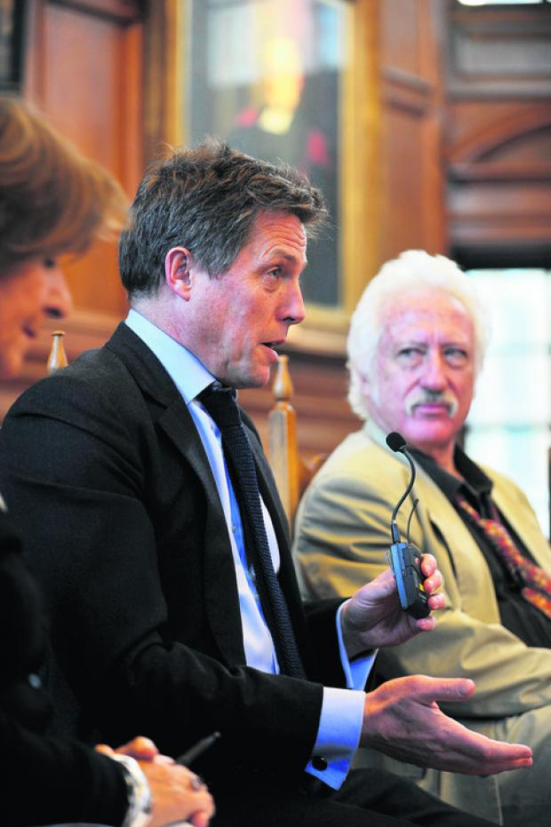 Hugh Grant and Bill Heine at the debate