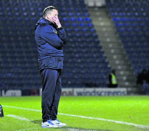 Chris Wilder looks on as his Oxford United side fall to defeat at Chesterfield on Saturday