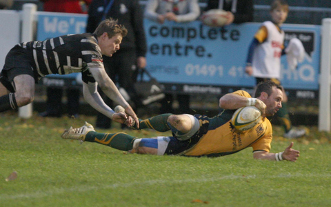 Henley's Richard Briggs slides in to score against Chinnor, evading wing Tom Gray