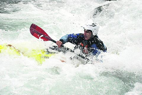 David Surman canoeing in the Alps