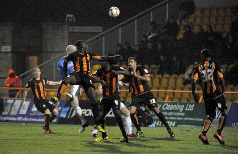 Andy Whing scores with a header