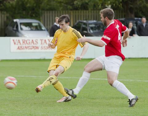 Abingdon striker Aaron Woodley is a transfer target of Division 1 South & West rivals Didcot Town