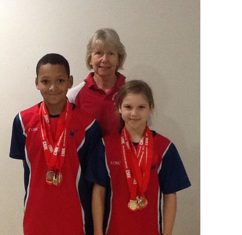 Gold medallosts Joseph McLean and Erin Gilchrist with City of Oxford coach LizHouse