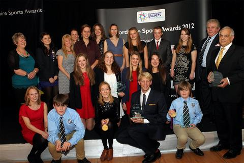 London 2012 rowing medallists Lily van den Broecke and Andy Triggs Hodge (front centre) show off their trophies along with all the other winners at a glittering Oxfords Sports Awards evening at Oxford United's Kassam Stadium last night