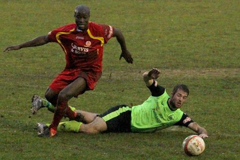 Banbury United's two-goal hero, Adeyinka Talabi, beats Hemel Hempstead Town's David King only to see the ball go out of play