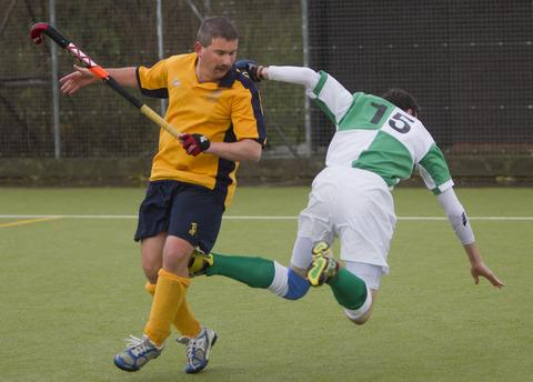 Wallingford's Tim Chamberlain is sent flying during Saturday's 2-0 defeat against Henley
