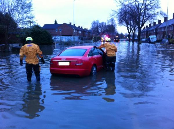 Firefighters help drivers in Abingdon Road