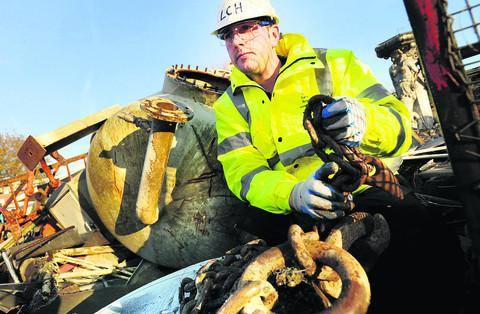 Gareth Hughes, of LC Hughes scrap dealers, at his yard in Bicester. Picture: OX55957 Richard Cave