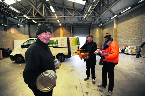 Robin Aitken and volunteers Phil Harriss and Chaka Artwell in the new warehouse