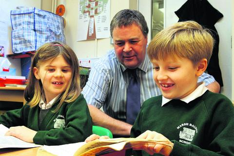 Headteacher Nick Pitson and Olena Rawlinson, left, discuss Harry Potter with George Smithson