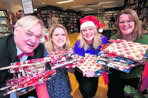 David Fickling, of David Fickling Publishing; Rebecca Waiting, manager of Blackwell's children's section; Sally Hutton, regional fundraiser, The Children's Society; and Roxanne Macmillan, of The Children's Society, launch the giving tree