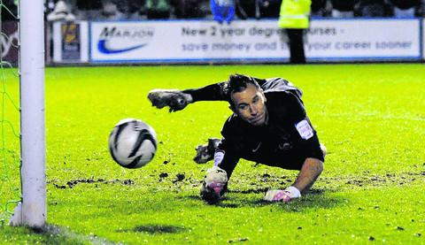 Oxford Mail: Ryan Clarke saves the first of two penalties on Tuesday, after telling the takers he would stay in the middle of the goal
