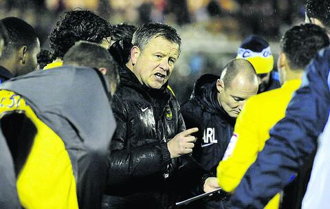 Chris Wilder gives his instructions before the shoot-out win at Plymouth on Tuesday  Picture: David Fleming