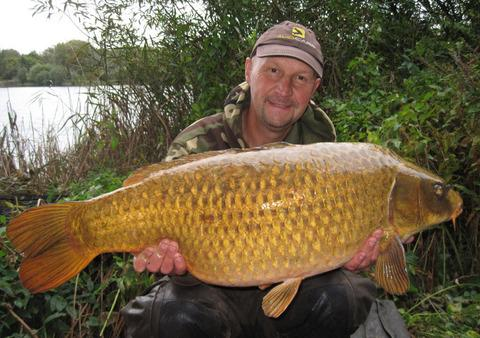 Oxford Mail: Ian Russell with a handsome 28lb ghost carp caught from Linear Fisheries' Unity Lake at Stanton Harcourt