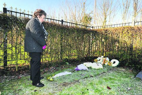 Oxford Mail: Jackie Flynn at the new grave plot for her late husband Peter. Picture: OX56052 Jon Lewis
