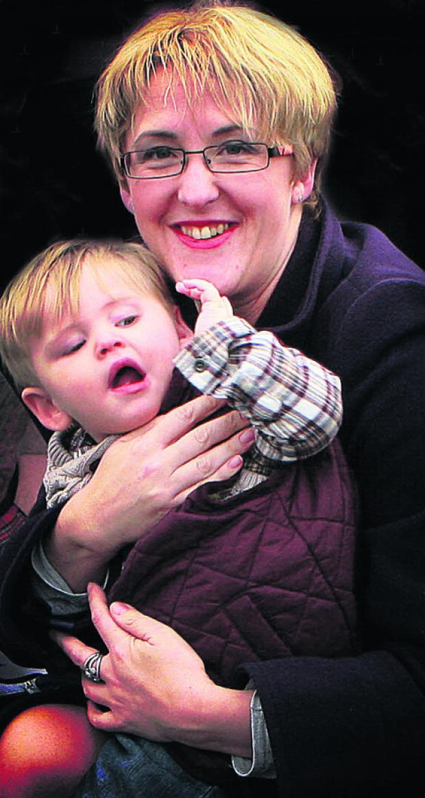 Mum Claire Logan holds little Albie