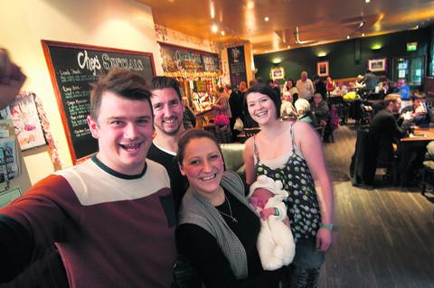 Left to right: David Patalong, Shaun McGonigal, Lauren Magill holding baby Oliver, and Anna Llewelyn