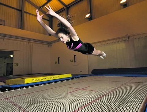 Jemma West, 13, does a front drop on the trampoline. Picture: OX56026 Antony Moore