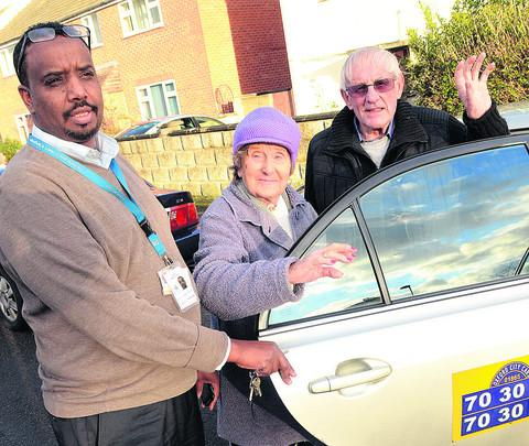 Driver Ali Hamoud helps Joyce, 88, and Fred Tanner, 78, on their way home