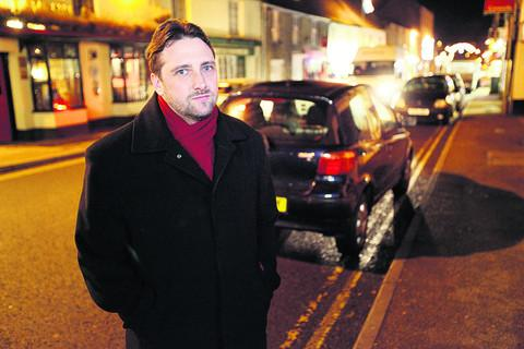 Councillor Andrew Coles with illegally parked cars in Corn Street, Witney