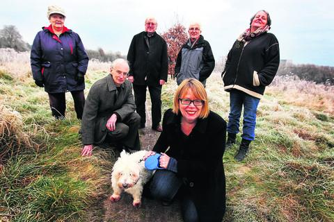 From left, Friends of Warneford Meadow Joanna Long, Graeme Salmon, Andrew Carter, David Sutton, Anne Copley and Sietske Boeles, front, with Charlie the dog, at the meadow.  Picture: OX56213 Ed Nix