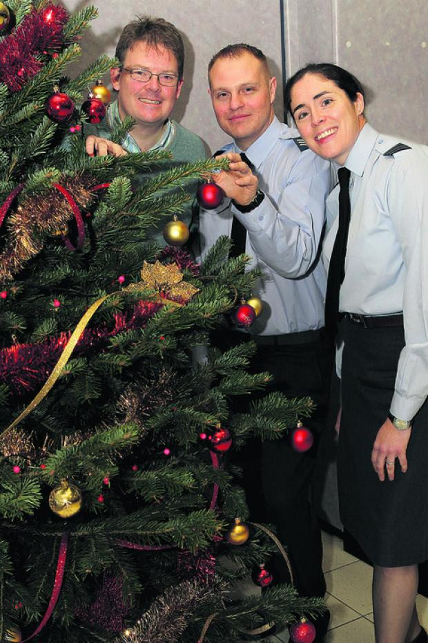 Boyd Douglas-Davies, Sgt Chris Shepherd and Wing Commander Angela Baker with the tree
