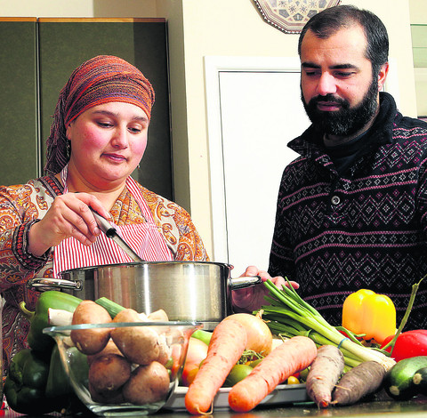 Cherie Waqar and Vic Altaf, of of Sufi Spice, in North Leigh,  prepare curries for sale at Witney Farmers' Market