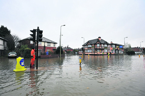 Residents recall floods of yesteryear on major road