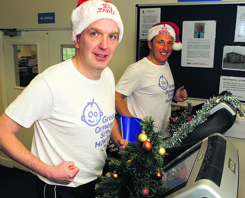 Flt Sgt Andy Gibson, left, and Sgt Spike McKee running on exercise machines at RAF Brize Norton to help Great Ormond Street Hospital