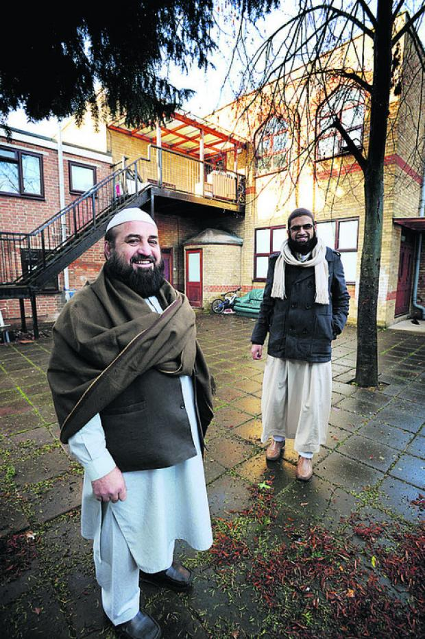 Imams Ataullah Khan, left, and Muhammed Ahmed Qazi at the rear of the building where the extension may be built