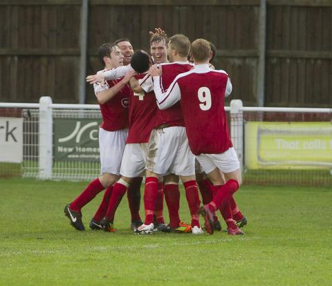 Ryan Tappin celebrates scoring a cracking goal with his Didcot Town teammates