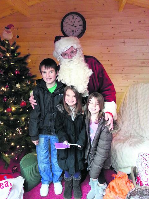 Siblings Ryan, Amy and Katie Kennett with the Santa Claus who was dismissed from Notcutts garden centre