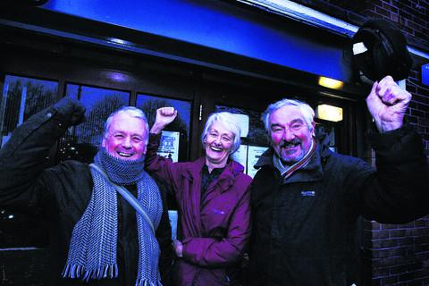 Ray James, Ginnie Herbert and Terry Kirkby celebrate after plans for a new community centre for Rose Hill were approved