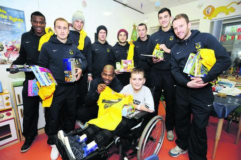 Josh Dodd, 12, meets Michael Duberry, centre, and other players behind, from left, Liam Davis, Luke O'Brien, Harry Worley, Lee Cox, Jake Forster-Caskey, James Constable, Max Crocombe and Sean Rigg. Pictures: OX56372 David Fleming