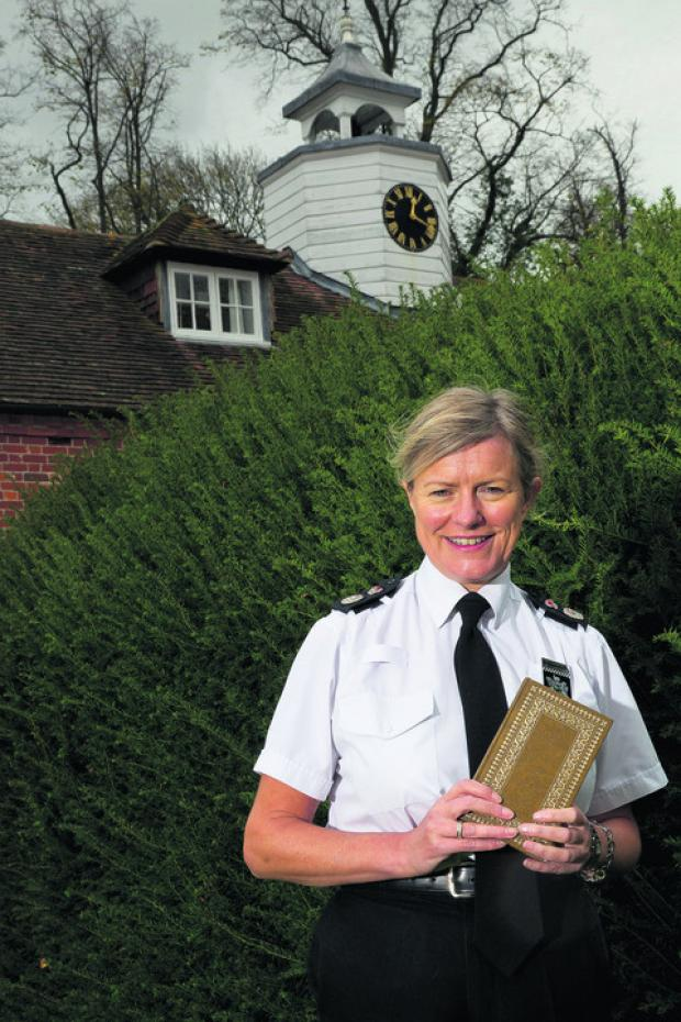 Sara Thornton, Chief Constable of Thames Valley Police, holds a copy of Jane Eyre by Charlotte Bronte