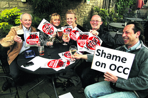 Campaigners celebrate after the Cogges Link Road scheme collapsed in June