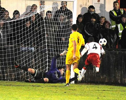Matt Ingram pulls off one of his many fine saves, this time from Eddie Odhiambo